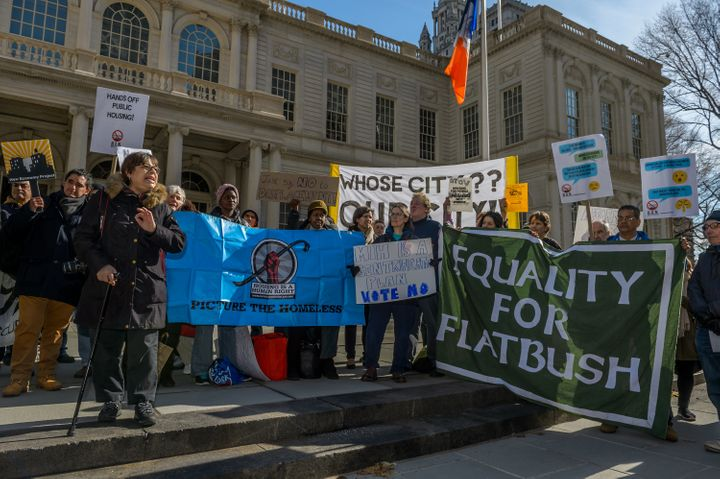 Activists from East Harlem and other neighborhoods rally against a major component of New York City Mayor Bill de Blasio's af