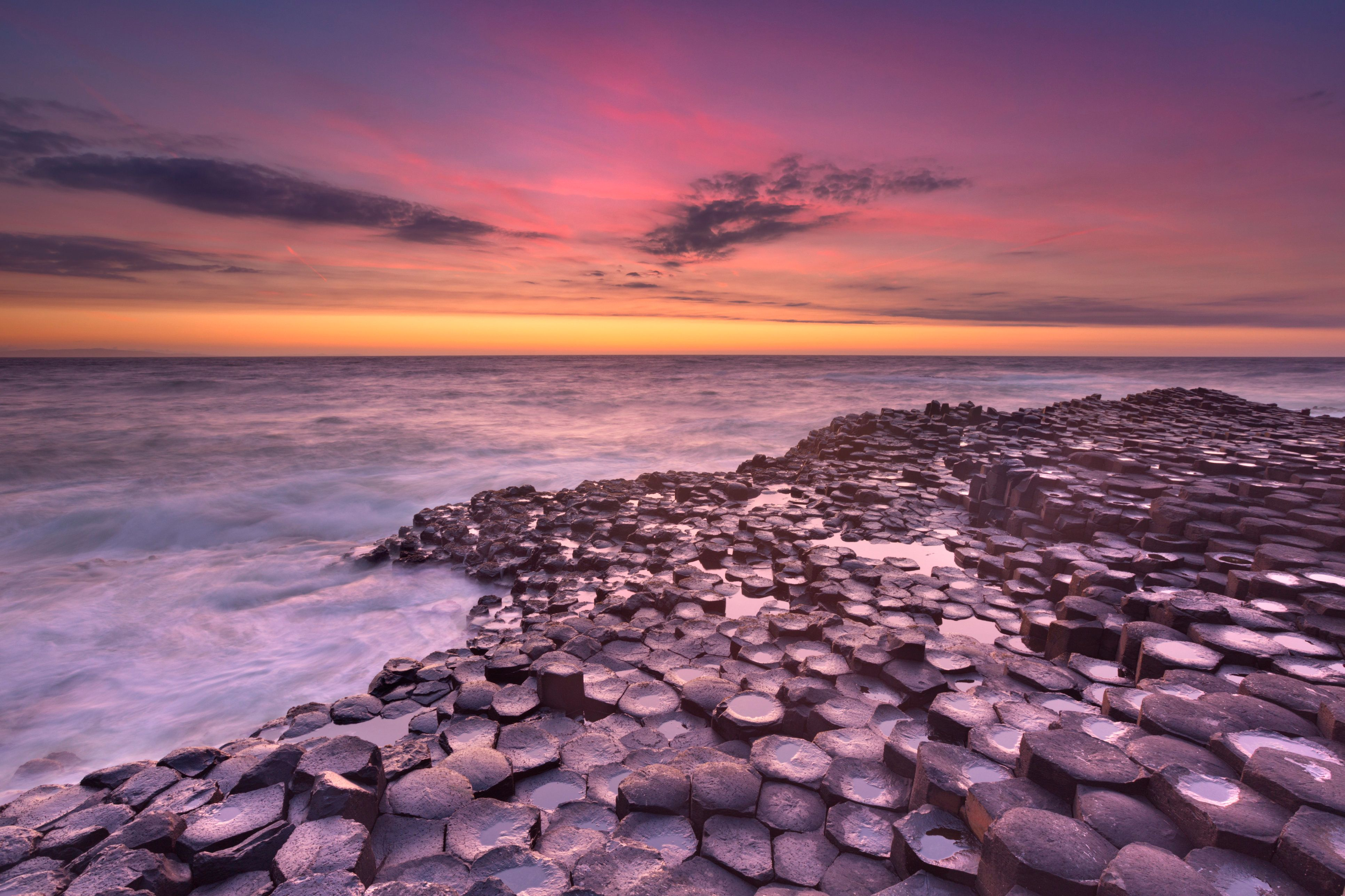 Sunset over the basalt rock formations of Giant's Causeway.