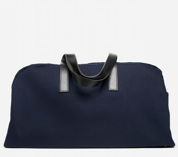 "<a href=""https://www.everlane.com/collections/womens-backpacks-bags/products/womens-twill-weekender-navy-black-leather"" targe"