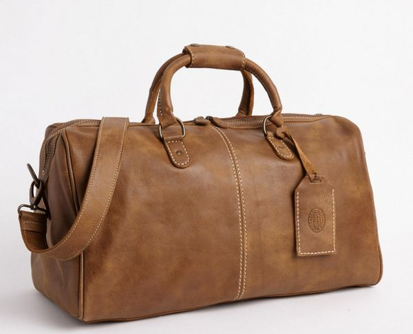 "<a href=""http://www.roots.com/us/en/small-colorado-bag-tribe-18048674.html?cgid=leatherWeekenderBags-Womens&start=6&s"