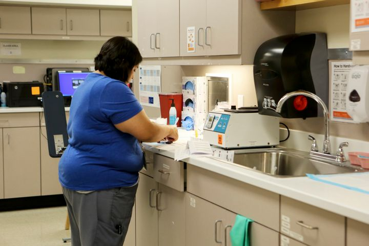 A staff member at Planned Parenthood South Austin Health Center labels blood samples at the clinic in Austin, Texas, U.S. Jun