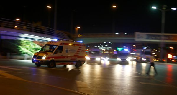 <i>Ambulances arrive at the airport.</i>