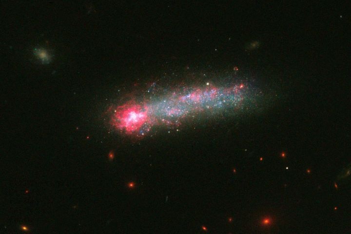 Kiso 5639, a dwarf galaxy about 82 million light years from Earth, resembles a rocket.