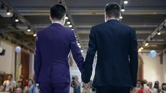 CHANGSHA, CHINA - MAY 17:  (CHINA OUT) Sun Wenlin (L) and his same-sex partner Hu Mingliang hold wedding in Changsha on May 17, 2016 in Changsha, Hunan Province of China. Furong District people's court judged China's first same-sex marriage case on April 13 and the plaintiffs Sun Wenlin and Hu Mingliang lost the case. Sun and Hu held their wedding in Changsha on May 17, and had planned to hold 100 same-sex weddings for gay couples.  (Photo by VCG/VCG via Getty Images)