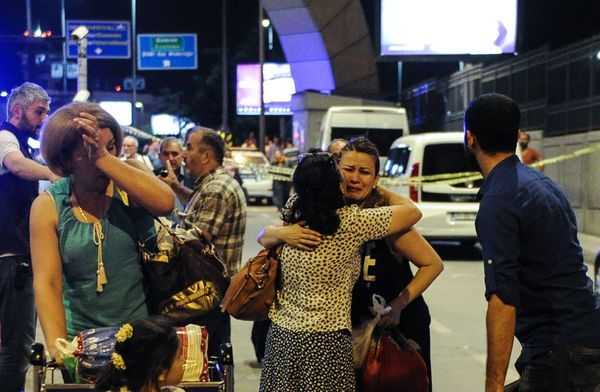 <i>People cry as they reunite outside the airport.</i>