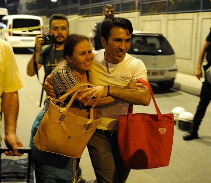 People leave Istanbul's Ataturk Airport after an attack by suicide bombers.