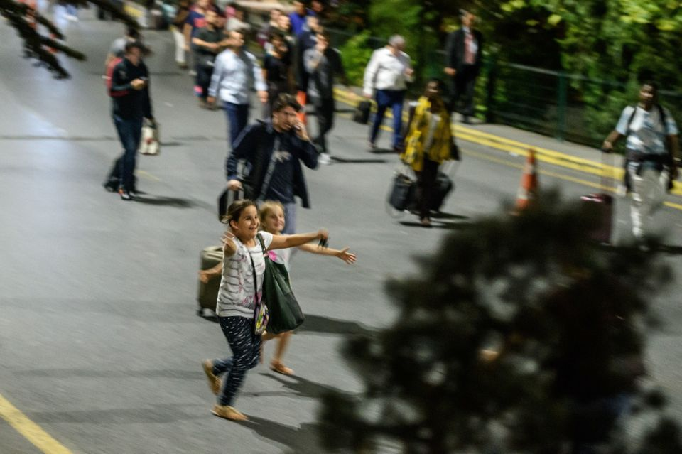<i>Children run to their relatives after leaving the airport.</i>
