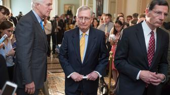 UNITED STATES - JUNE 28: From left, Senate Majority Whip John Cornyn, R-Texas, Majority Leader Mitch McConnell, R-Ky., and Sen. John Barrasso, R-Wyo., conclude a news conference after the Senate Policy luncheons in the Capitol, June 28, 2016. (Photo By Tom Williams/CQ Roll Call)