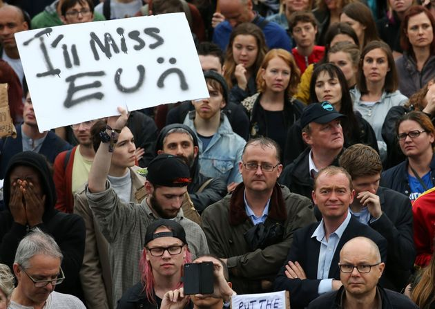 Liberal Democrat leader Tim Farron (below right, blue shirt) joins people at an anti-Brexit protest in...
