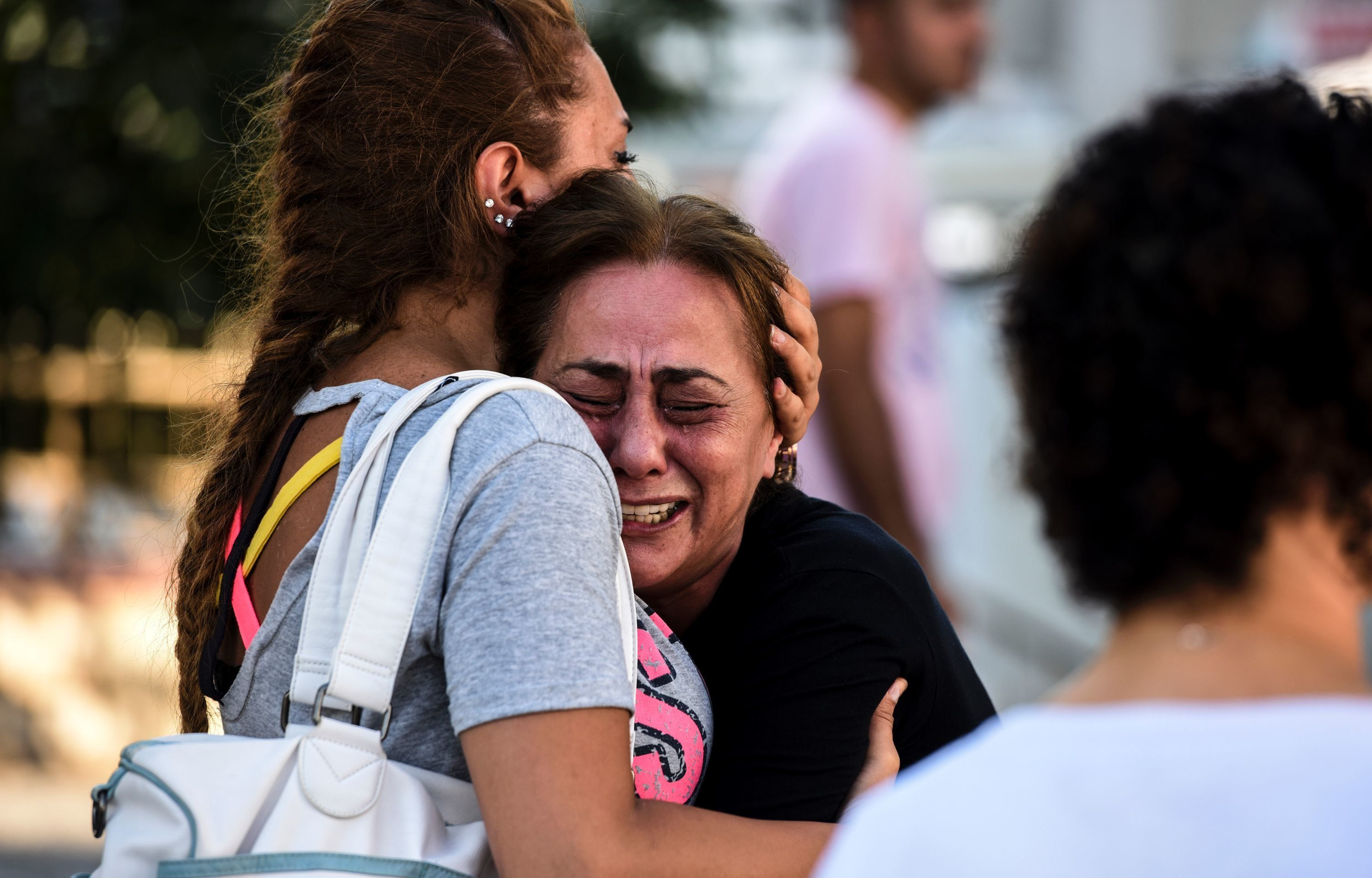 A woman cries outside a forensic medicine building close to Istanbul Ataturk Airport on June...