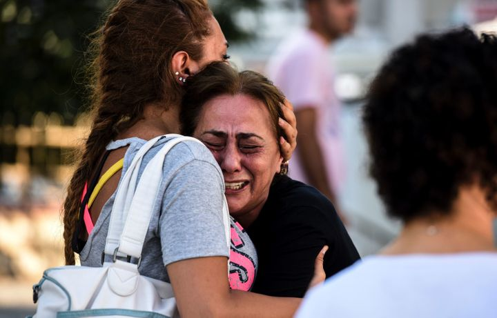 A woman cries outside a forensic medicine building close to Istanbul Ataturk Airport on June 29, a day after a trip