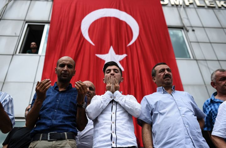 People mourn atthe funeral of one of the victims of the Istanbul airport bombing.