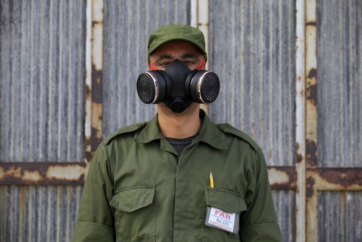 Eloy, 38, a Cuban military reservist who is working in a fumigation campaign against the&nbsp;<i>Aedes aegypti</i> mosquito, posses for a picture in Havana in February 2016.
