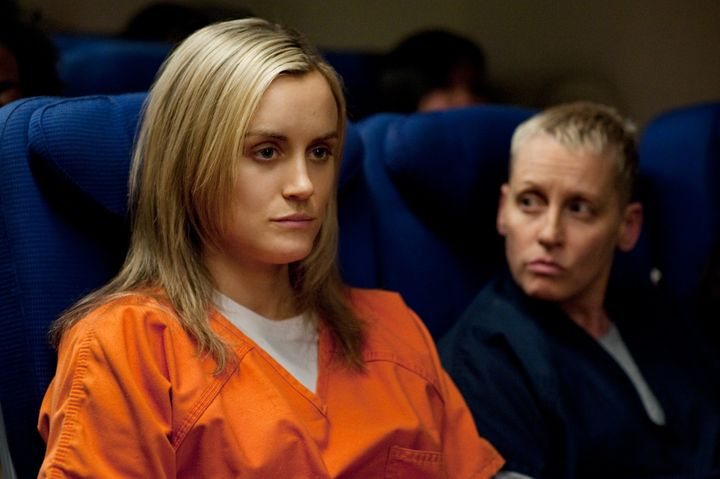 "Taylor Schilling and Lori Petty star in a scene from Season 2 of ""Orange is the New Black."""