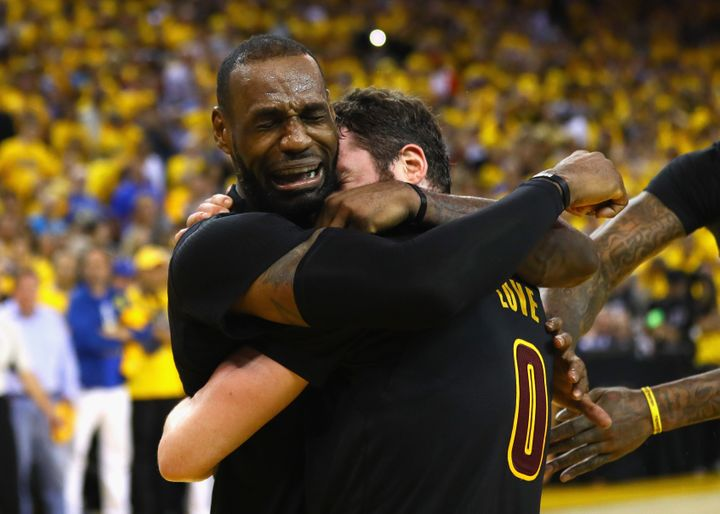LeBron James and Kevin Love embrace after winning Game 7 of the 2016 NBA Finals.