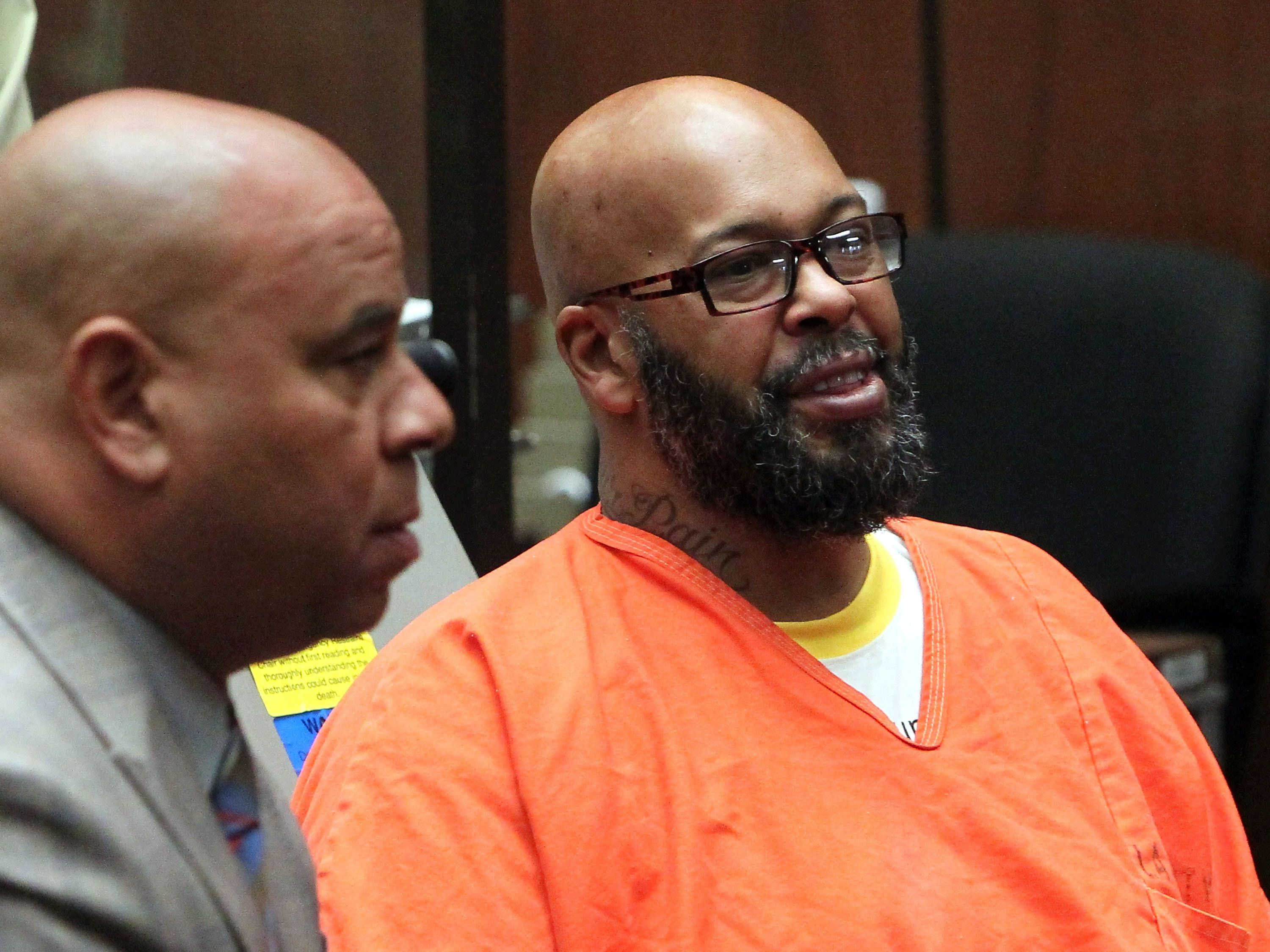 LOS ANGELES, CA - APRIL 08:  Marion 'Suge' Knight (R) appears in court with his Lawyer Matthew P Fletcher for a preliminary hearing in a robbery charge case at Criminal Courts Building on April 8, 2015 in Los Angeles, California.  Knight is charged with robbery and criminal threats after allegedly stealing a photographer's camera during an incident September 5, 2014 in Beverly Hills.  (Photo by David Buchan/Getty Images)