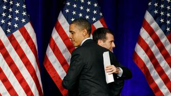 U.S. President Barack Obama gets a hug from senior advisor David Plouffe as he arrives to speak at a DNC event in Washington, March 16, 2011.   REUTERS/Jim Young      (UNITED STATES - Tags: POLITICS)