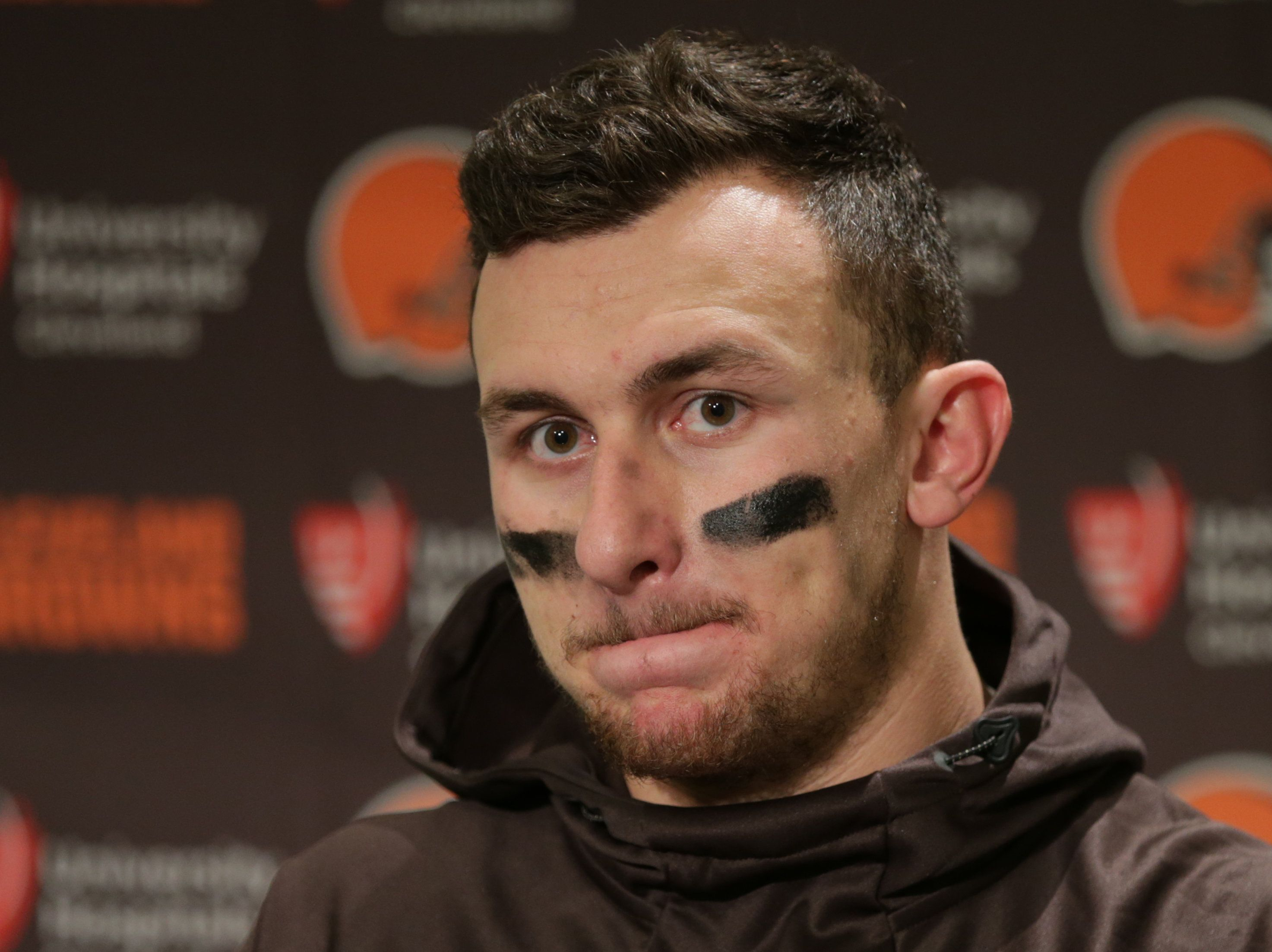 FILE - In this Dec. 20, 2015, file photo, Cleveland Browns quarterback Johnny Manziel speaks with media members following the team's 30-13 loss to the Seattle Seahawks in an NFL football game, in Seattle. A Dallas judge has set a $1,500 bond for former Cleveland Browns quarterback Johnny Manziel in his misdemeanor domestic assault case. (AP Photo/Scott Eklund, File)