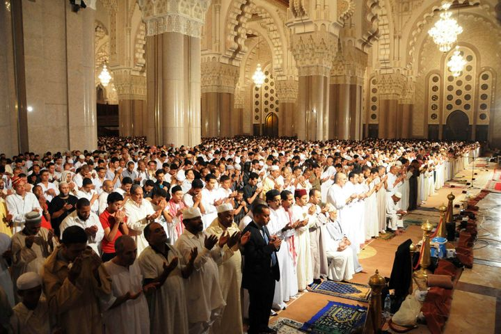 Moroccan faithful pray on the esplanade of the Hassan II Mosque on Laylat al-Qadr during the holy month of Ramadan, in Casabl