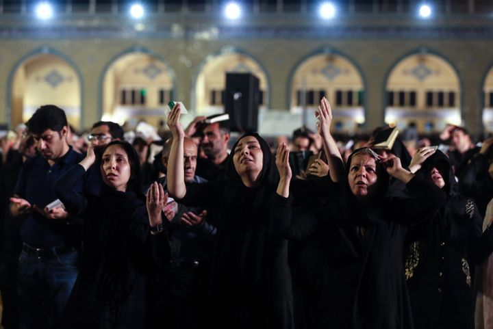 People pray at Mosalla Mosque on the 21th day of Ramadan. Iranian people assume that 19th, 21st and 23rd days of Ramadan