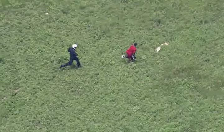 A burglary suspect is seen being chased down by a Houston tactical flight officer on Tuesday.