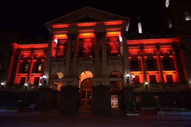 Municipality of Melbourne building lit up in the colors of the Turkish national