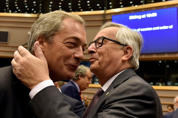 European Commission President Jean-Claude Juncker welcomes Nigel Farage, the leader of the United Kingdom Independence Party,
