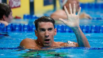 Jun 29, 2016; Omaha, NE, USA; Michael Phelps holds up five fingers during the finals for the men's 200 meter butterfly in the U.S. Olympic swimming team trials at CenturyLink Center. Mandatory Credit: Erich Schlegel-USA TODAY Sports