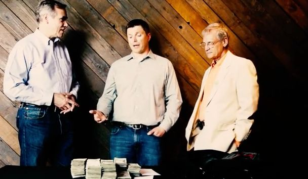 From left to right: Sen. Jeff Merkley, a pile of drug money, cannabis business owner Tyson Haworth, Rep. Earl Blumenauer