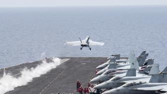 A U.S. Navy F/A-18E Super Hornet fighter jet launches from the flight deck of the aircraft carrier USS Harry S. Truman in the Mediterranean Sea in a photo released by the US Navy June 3, 2016. U.S. fighter jets on Friday launched strikes against Islamic State from the USS Harry S. Truman aircraft carrier, the U.S. Navy said, marking the first time a U.S. aircraft carrier targeted areas in the Middle East from the Mediterranean since the Iraq War began in 2003.    U.S. Navy/Mass Communication Specialist 3rd Class Bobby J Siens/Handout via REUTERS   ATTENTION EDITORS - THIS PICTURE WAS PROVIDED BY A THIRD PARTY. FOR EDITORIAL USE ONLY