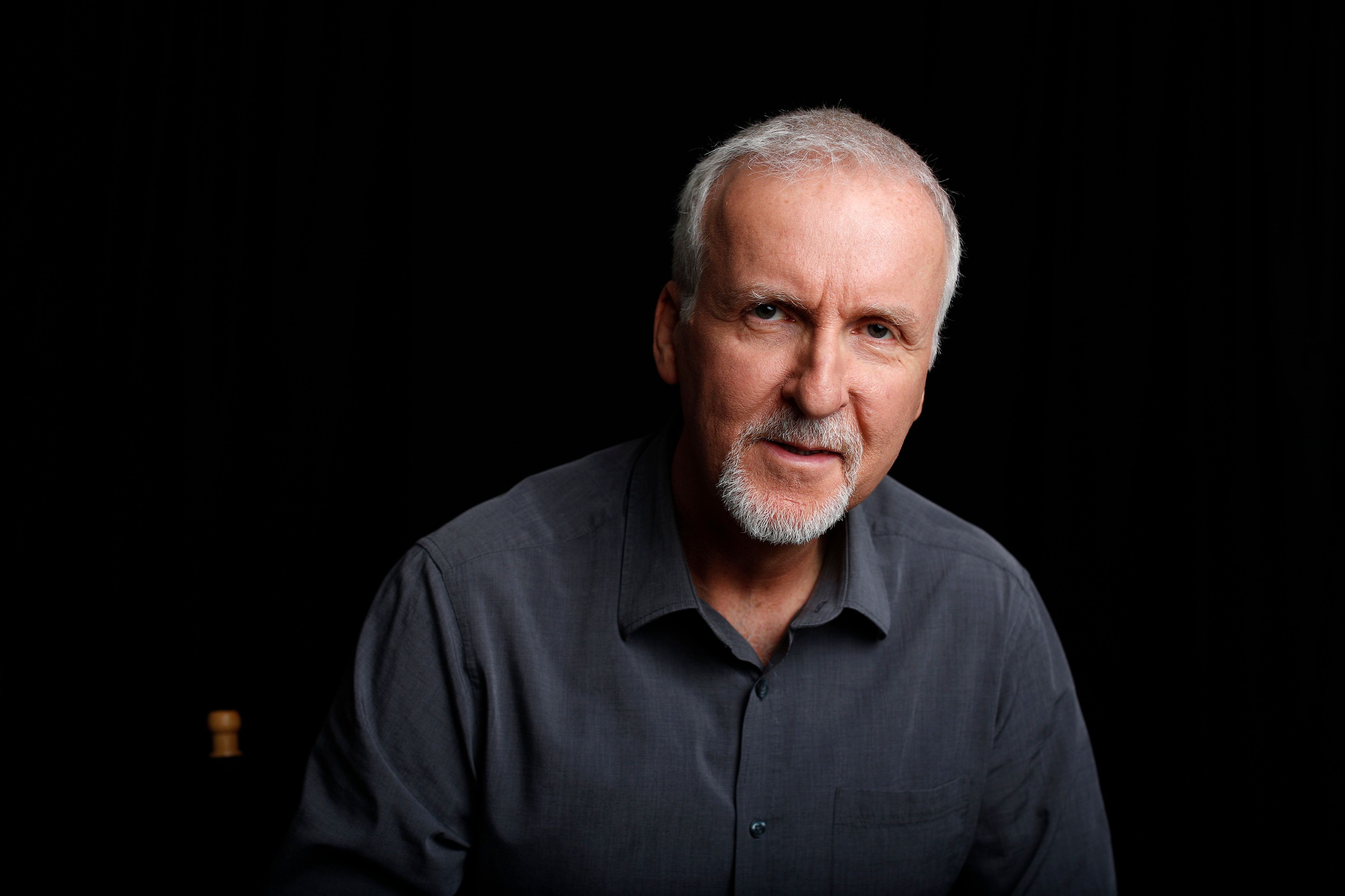 "Director James Cameron poses for a portrait in Manhattan Beach, California April 8, 2014. Cameron, best known as director of blockbuster films ""Titanic"" and ""Avatar"", has appealed to well-known Hollywood actors to act as correspondents for new Showtime documentary ""Years of Living Dangerously"", which chronicles the human impact on the global climate and the consequences for humans of climate change. Picture taken April 8, 2014. To match story TELEVISION-CLIMATECHANGE/      REUTERS/Lucy Nicholson (UNITED STATES - Tags: ENTERTAINMENT ENVIRONMENT PROFILE PORTRAIT)"
