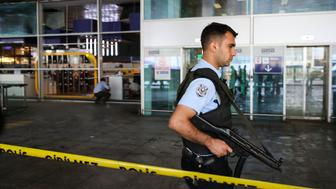 ISTANBUL, TURKEY - JUNE 29: A Turkish police stands guard at the Ataturk International Airport after the air traffic returned to normal following yesterday's terror attack in Istanbul, Turkey on June 29, 2016. At least 36 victims and three suicide bombers were killed while scores of others were injured in a terror attack on Istanbuls Ataturk International Airport. (Photo by Berk Ozkan/Anadolu Agency/Getty Images)