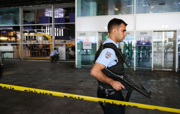 A Turkish police officer stands guard at Istanbul Ataturk Airport after air traffic returned to normal following the tri