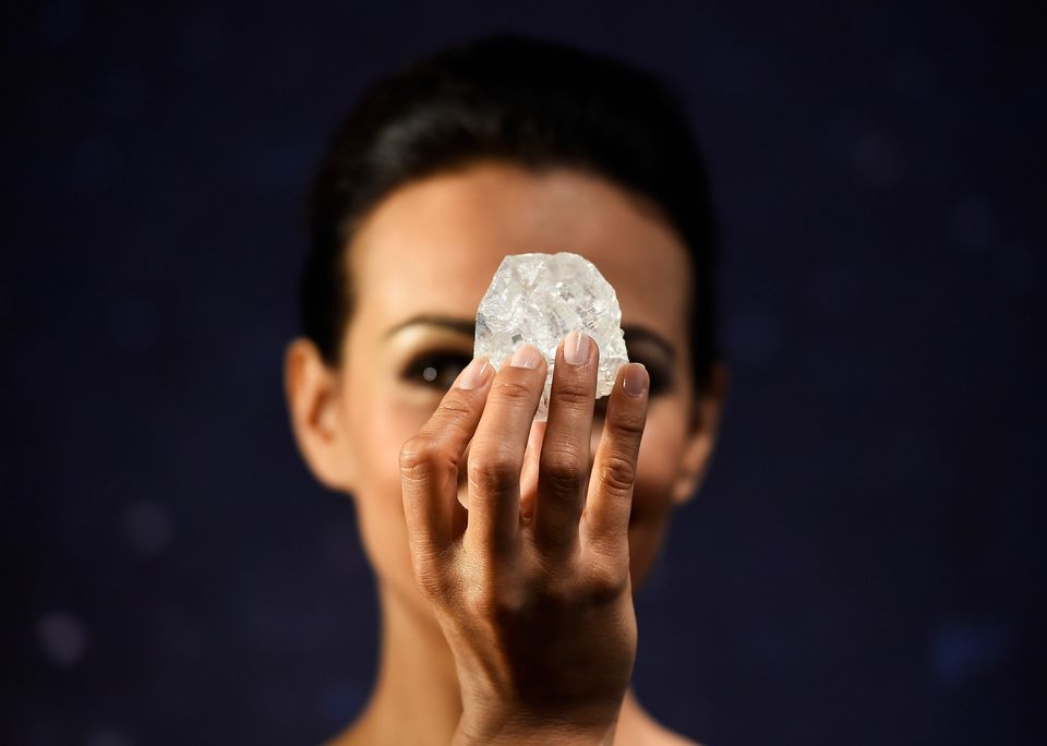 "A model shows off the 1,109-carat ""Lesedi La Rona,"" the largest gem-quality rough diamond discovered in over 100 years,"