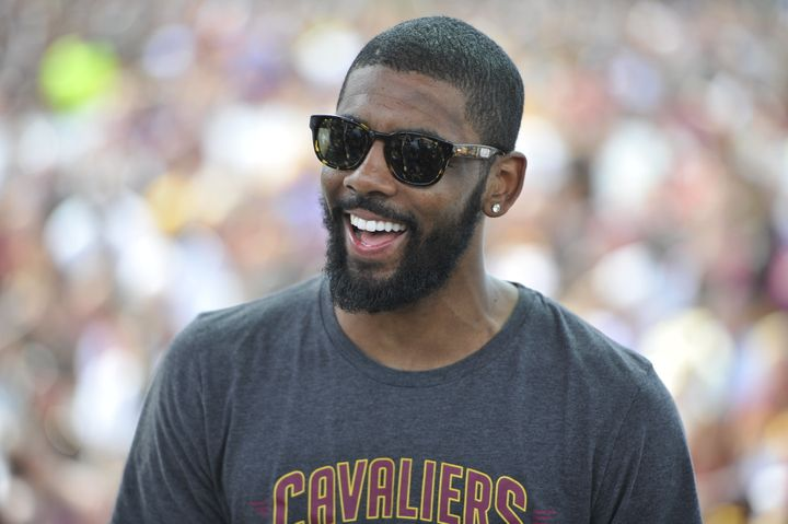 Kyrie Irving of the Cleveland Cavaliers speaks to the fans during the Cleveland Cavaliers Victory Parade.