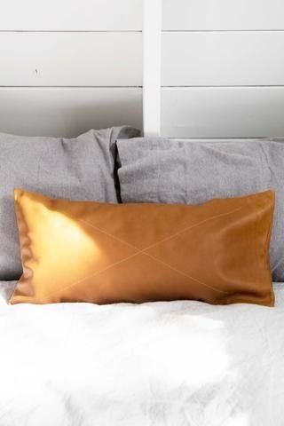 """<a href=""""http://www.accompanyus.com/collections/home/products/leather-safari-lumbar-pillow"""" target=""""_blank"""">Rose and Fitzgera"""