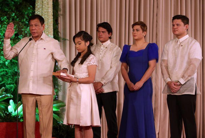 Newly elected President Rodrigo Rodrigo Duterte takes his oath of office as the 16th president of the Republic of the Philipp
