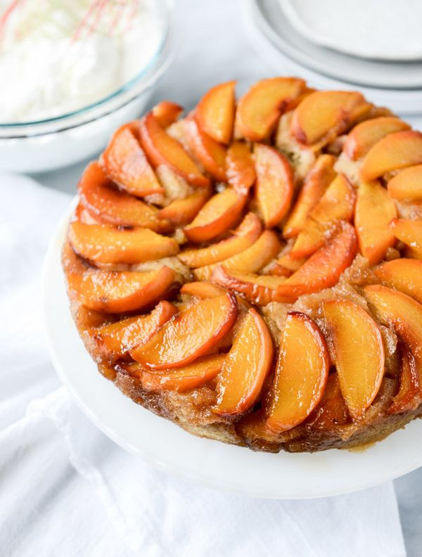 "<strong>Get the <a href=""http://www.howsweeteats.com/2015/08/cinnamon-sugar-bourbon-peach-upside-down-cake/"" target=""_blank"">"