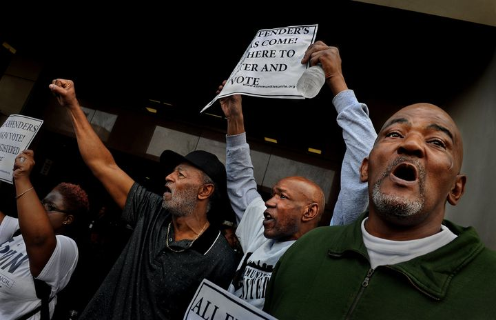 Prisoners' rights activists rally in Baltimore with several former felons and supporters to celebrate the first day