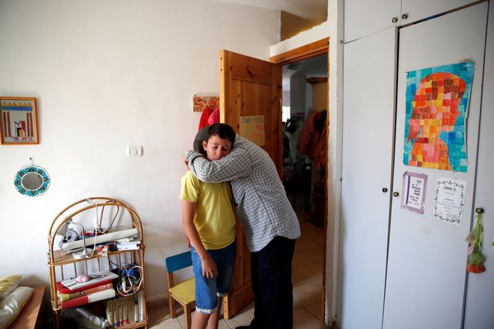 Relative comfort each other in Ariel's bedroom. Her attacker was shot dead and the Israeli premier said his home would b