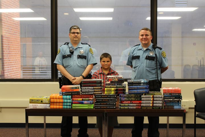 Tyler, posing with the books from the first drop-off.