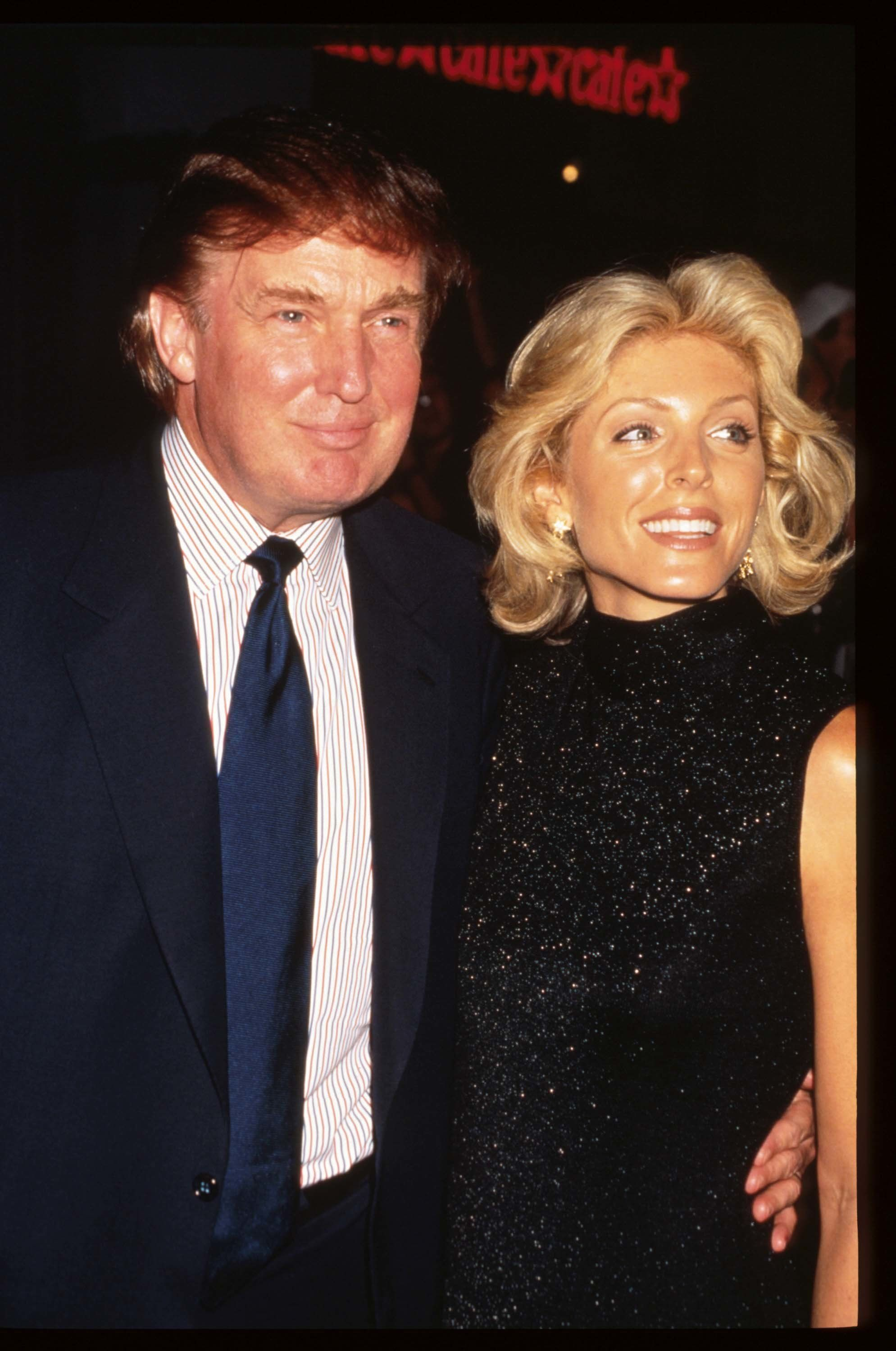 277721 01: Real estate mogul Donald Trump and wife Marla Maples attend the premiere of 'Tin Cup' August 6, 1996 in New York City. Kevin Costner was nominated for a 1997 Golden Globe for Best Performance by an Actor in a Motion Picture for his role as Roy ''Tin Cup'' McAvoy. (Photo by Evan Agostini/Liaison)