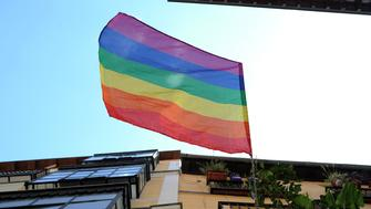 MADRID, SPAIN - JUNE 29:  A flag flies fromba building in central Madrid during the launching of the the 2016 Madrid Gay Pride Festival at Pedro Zerolo square on June 29 in Madrid, Spain. The five-day event opened with a homage to the victims of the Orlando massacre.  (Photo by Denis Doyle/Getty Images)