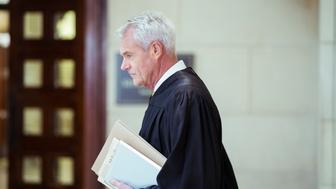 Judge walking through courthouse