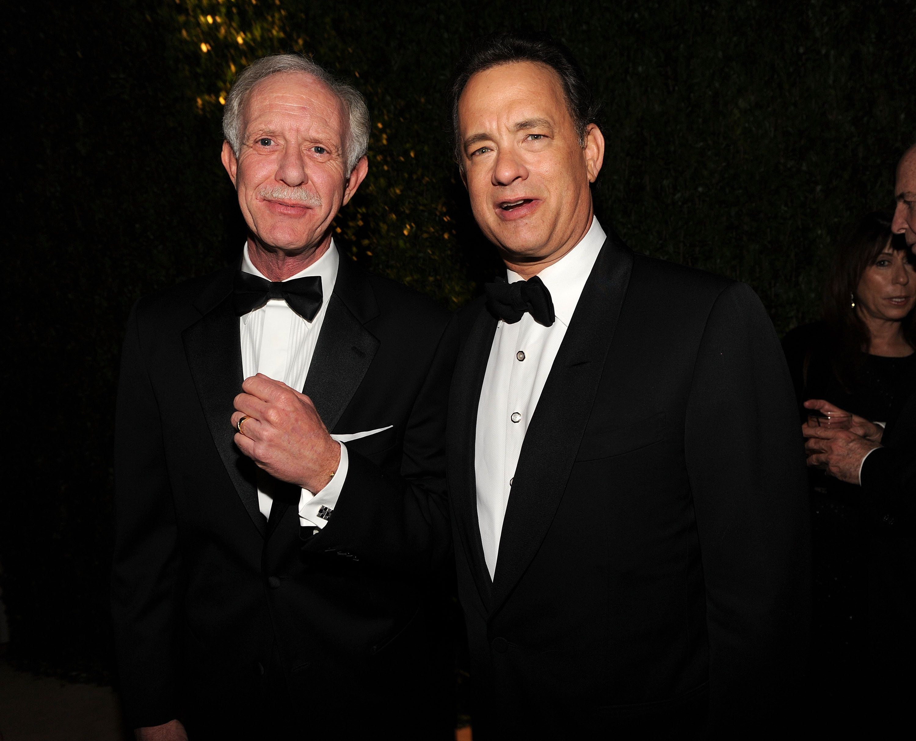 (EXCLUSIVE, Premium Rates Apply) WEST HOLLYWOOD, CA - MARCH 07:  *EXCLUSIVE* Pilot Chesley 'Sully' Sullenberger (L) and Tom Hanks attend the 2010 Vanity Fair Oscar Party hosted by Graydon Carter at the Sunset Tower Hotel on March 7, 2010 in West Hollywood, California. ***EXCLUSIVE ACCESS SPECIAL RATES APPLY; NO NORTH AMERICAN ON-AIR BROADCAST UNTIL MARCH 14TH, 2010***  (Photo by Kevin Mazur/VF1/WireImage)