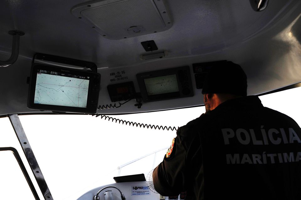 Capt. Carlos Rodrigues pages the Hellenic Coast Guard after spotting a raft on the boat's