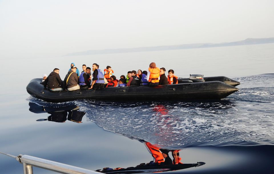The black rubber boat has people onboard who have fled Syria, Nigeria and the