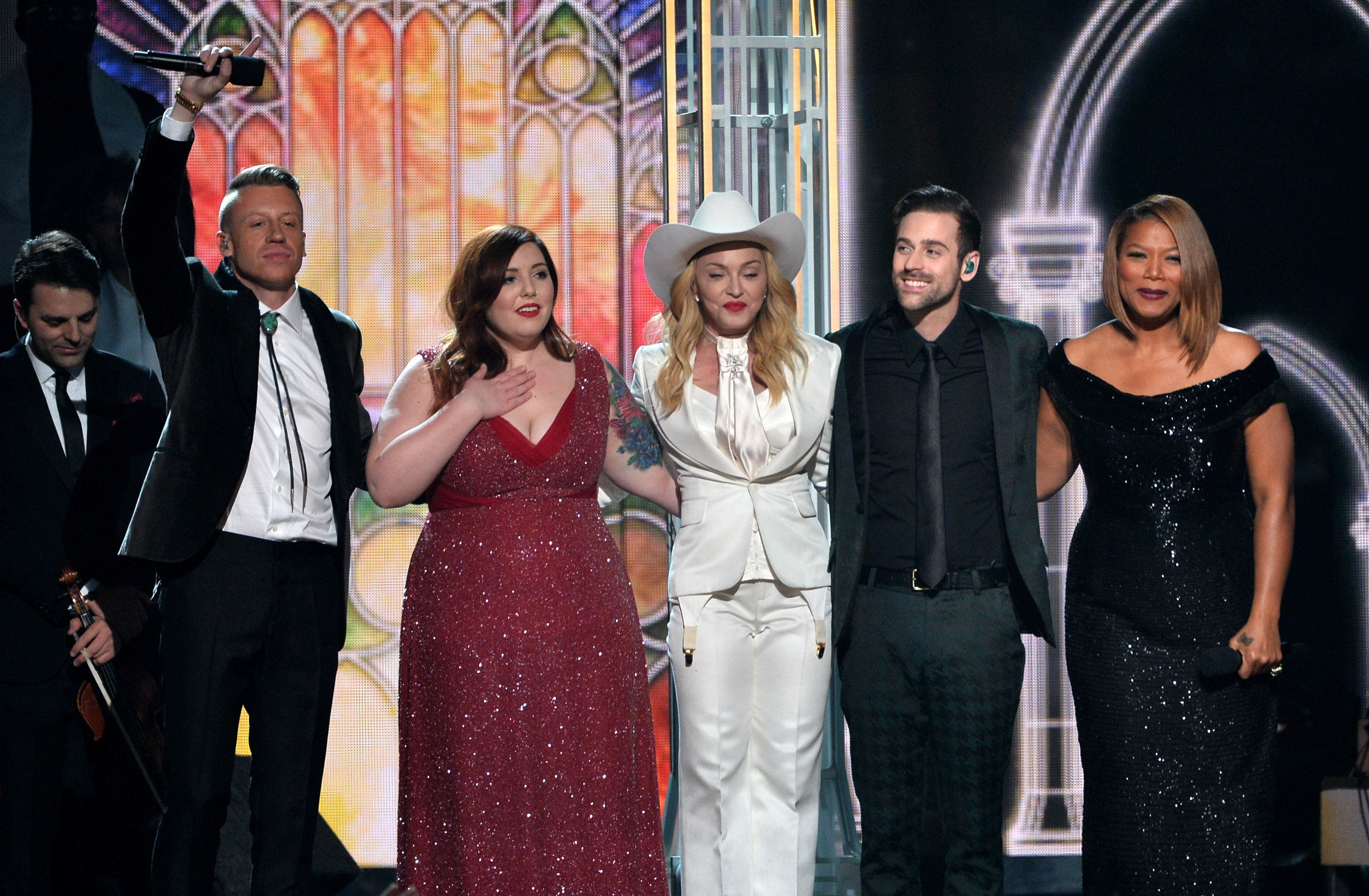 LOS ANGELES, CA - JANUARY 26:  (2nd L-R)Musicians Macklemore, Mary Lambert, Madonna, Ryan Lewis and Queen Latifah perform onstage during the 56th GRAMMY Awards at Staples Center on January 26, 2014 in Los Angeles, California.  (Photo by Kevin Winter/WireImage)