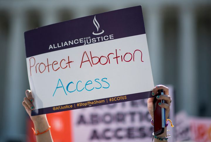 A federal judge on Thursday blocked a restrictive Indiana abortion law, citing a recent Supreme Court decision.