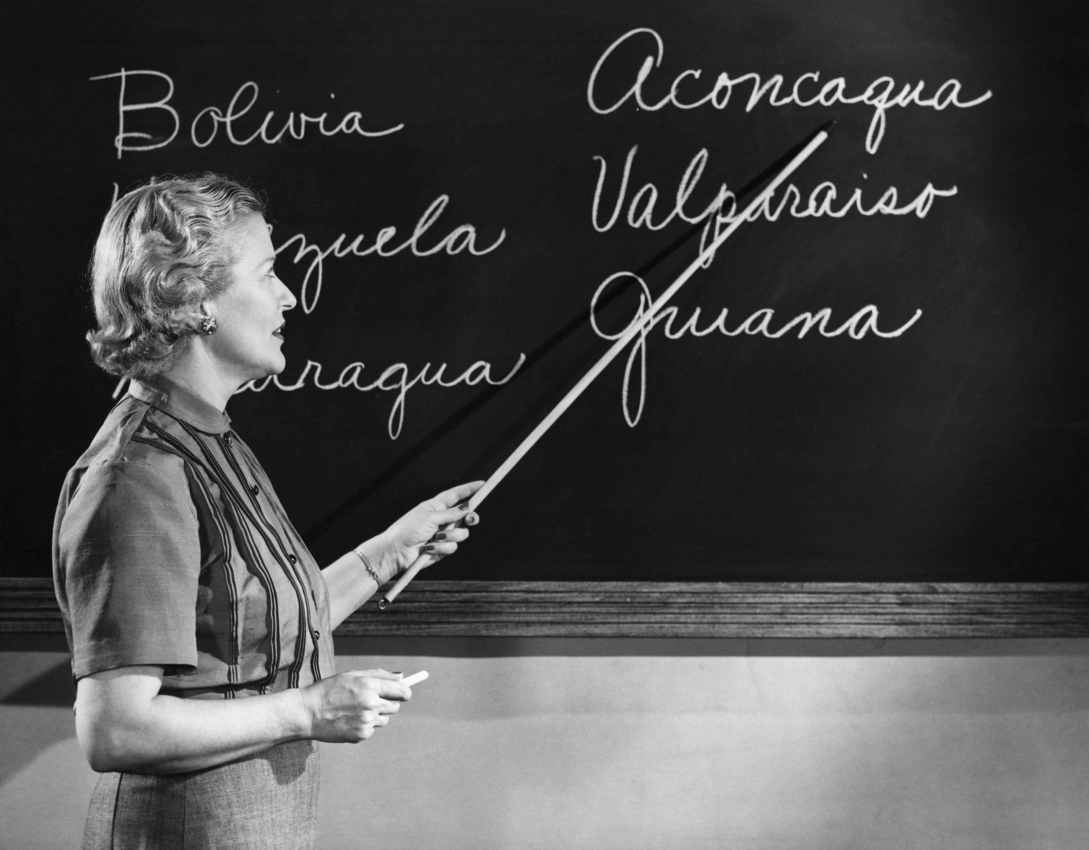 Side profile of a female teacher teaching in the classroom